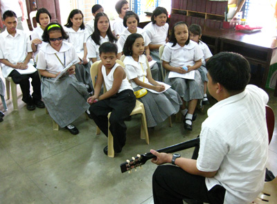 Blind disciplemaker with guitar and group